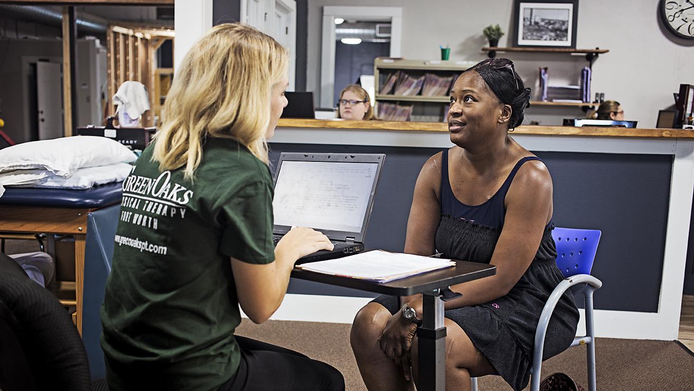 Therapist mobilizing patient neck