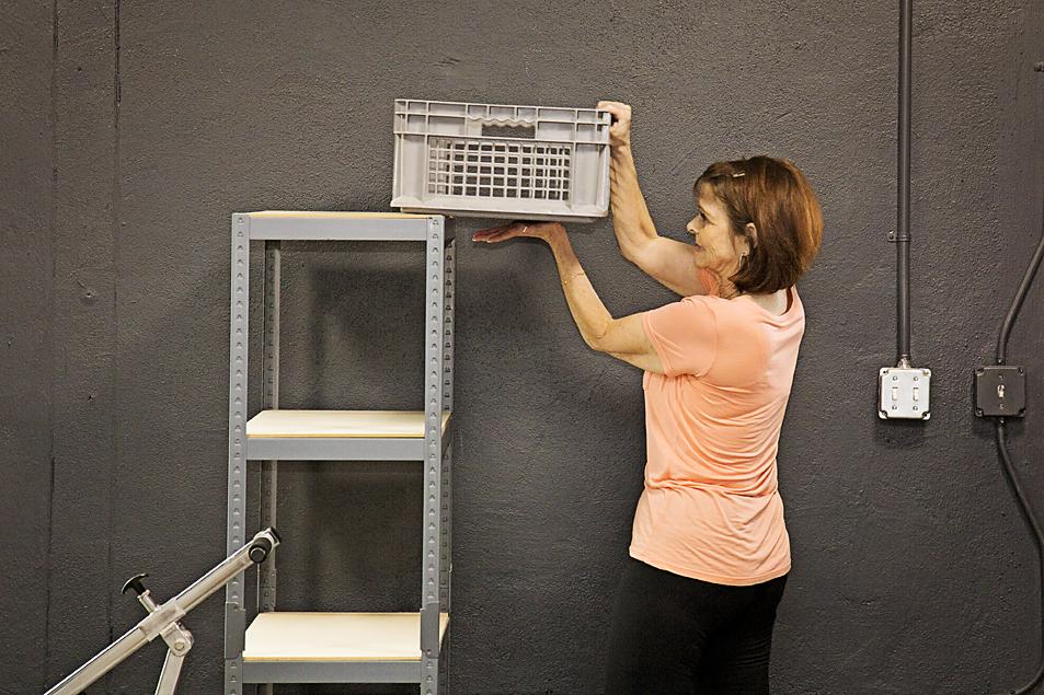 Patient lifting box onto shelf