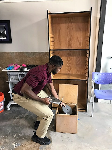 Patient putting weights in box