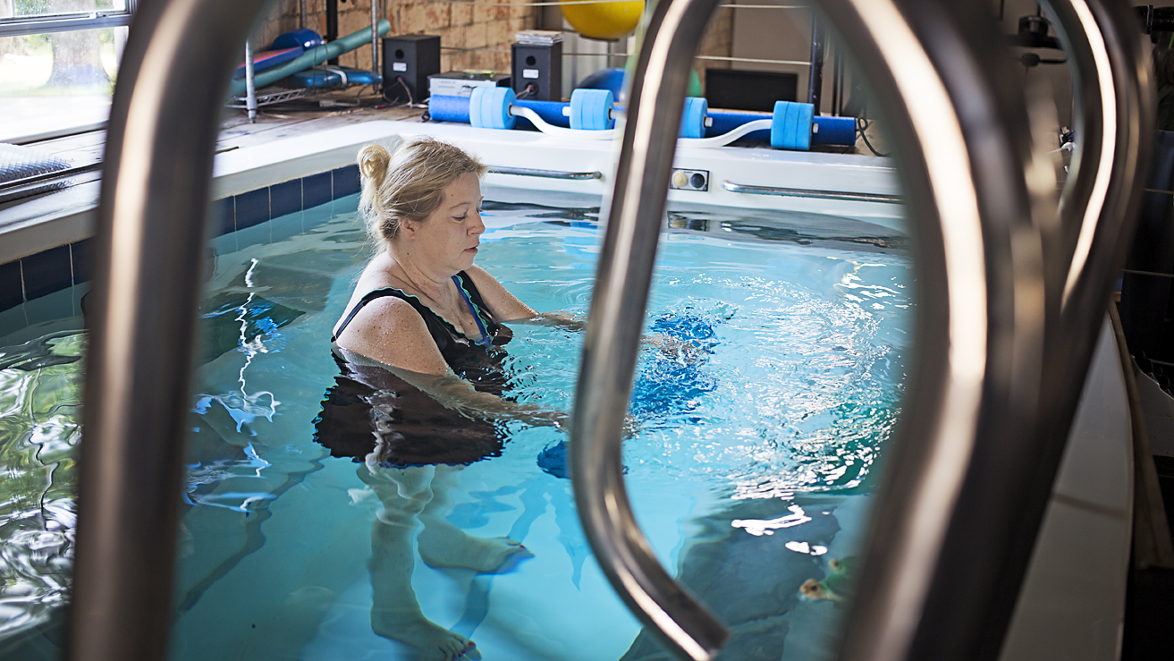 Patient exercising in pool